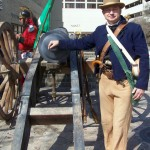 Reenactor with 18-lb cannon