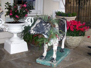 Garlanded Cow and Urns