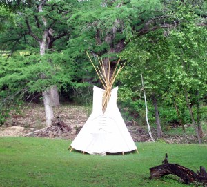 Tipi displayed on the banks of the creek