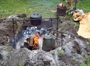 Cooking over a camp-fire meant a lot of pots, pans, and metal rods.
