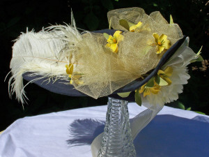 The late-Victorian hat; navy blue with yellow and cream trimming